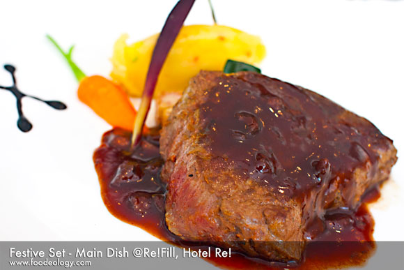 grilled beef tenderloin topped with foie gras red wine sauce, potato gratin, medley of vegetables